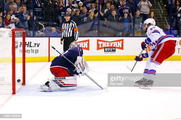 Mika Zibanejad of the New York Rangers beats Joonas Korpisalo of the Columbus Blue Jackets for a goal during the shootout on November 10 2018 at...
