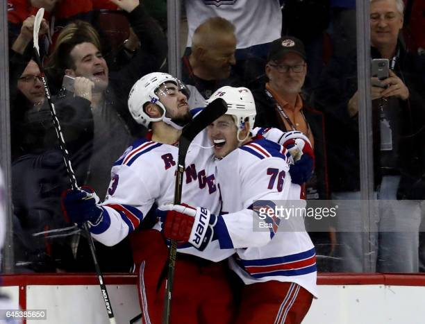 Mika Zibanejad of the New York Rangers celebrates his game winning goal with teammate Brady Skjei in overime against the New Jersey Devils on...
