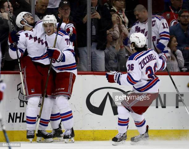 Mika Zibanejad of the New York Rangers celebrates his game winning goal with teammates Brady Skjei and Mats Zuccarello overime against the New Jersey...