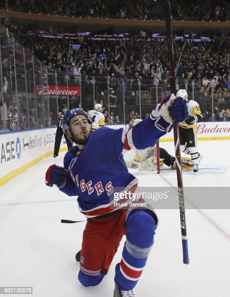 Mika Zibanejad of the New York Rangers celebrates his game winning goal at 253 of overtime against the Pittsburgh Penguins at Madison Square Garden...