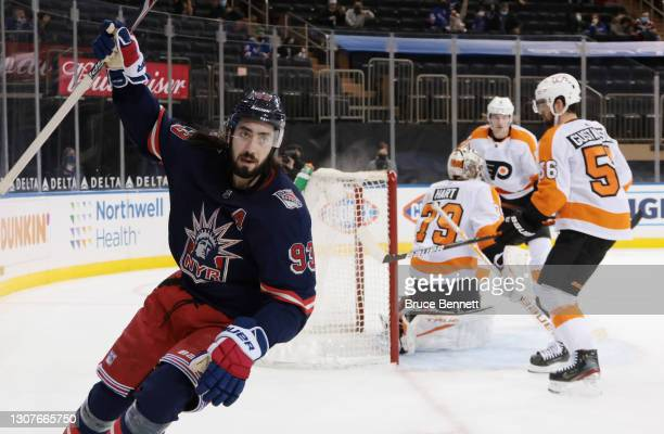 Mika Zibanejad of the New York Rangers celebrates his power-play goal at 14:29 of the second period against Carter Hart of the Philadelphia Flyers at...