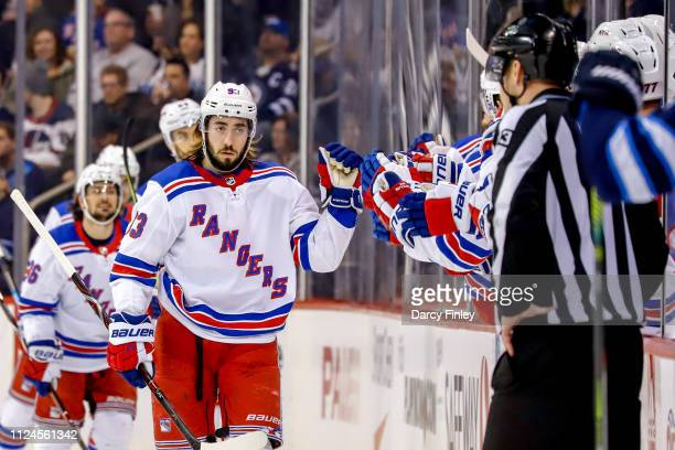 Mika Zibanejad of the New York Rangers celebrates his second period goal against the Winnipeg Jets with teammates at the bench at the Bell MTS Place...