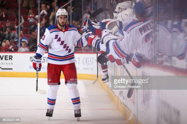 Mika Zibanejad of the New York Rangers celebrates with teammates on the bench after scoring a shootout goal against the Arizona Coyotes during the...