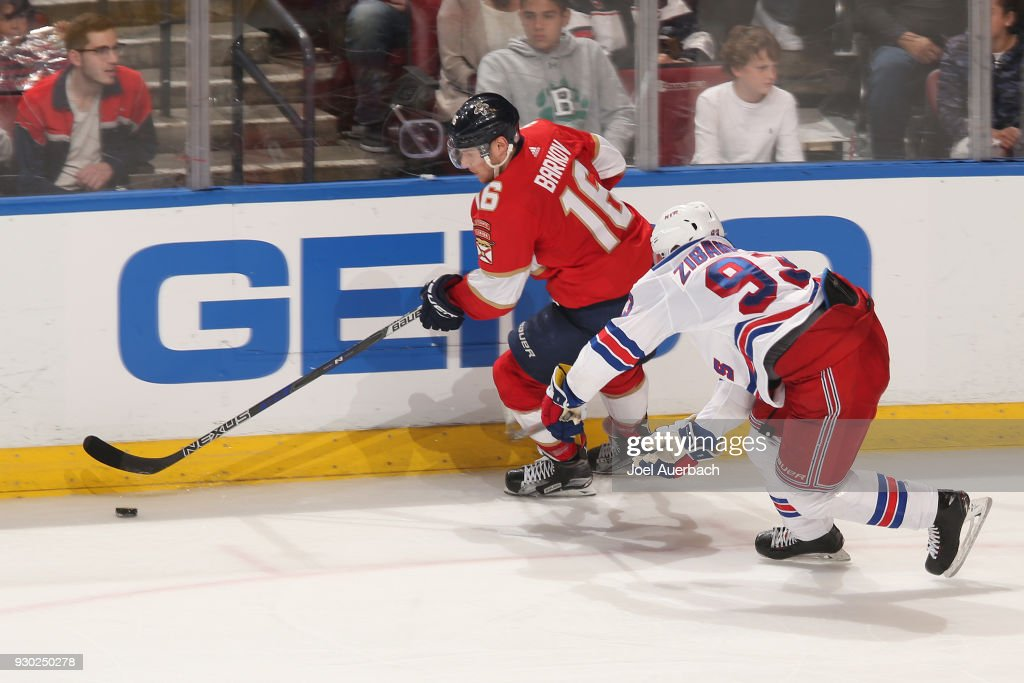 Mika Zibanejad #93 of the New York Rangers defends against Aleksander Barkov #16 of the Florida Panthers as he skates up ice with the puck at the BB&T Center on March 10, 2018 in Sunrise, Florida. The Panthers defeated the Rangers 4-3 in a shootout.