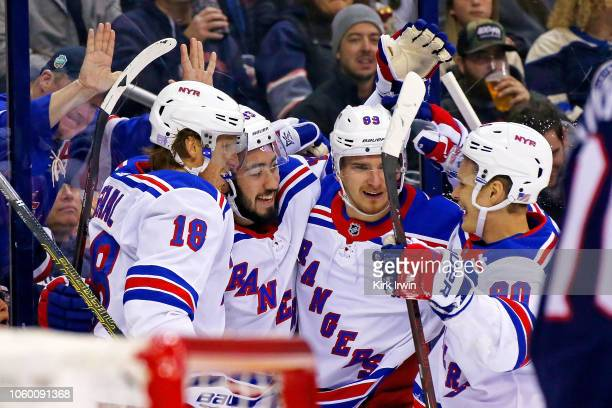 Mika Zibanejad of the New York Rangers is congratulated by his teammates after scoring a goal during the first period of the game against the...