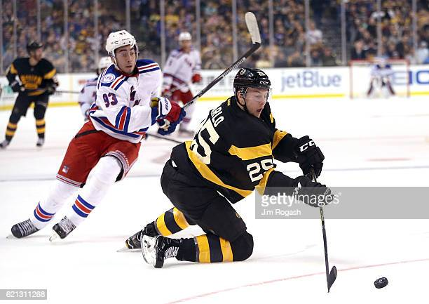 Mika Zibanejad of the New York Rangers presses as Brandon Carlo of the Boston Bruins defends in the Bruins zone in the second period at TD Garden on...