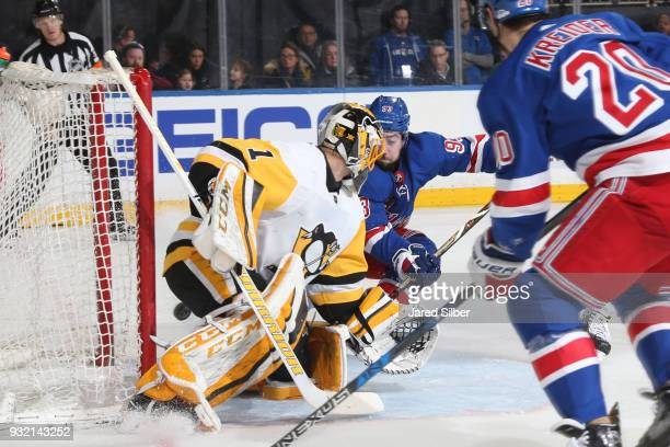 Mika Zibanejad of the New York Rangers scores a goal in the third period off a pass from Chris Kreider against Casey DeSmith of the Pittsburgh...
