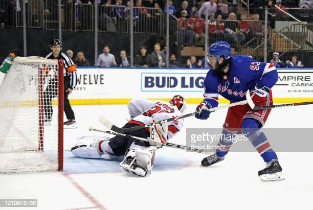 Mika Zibanejad of the New York Rangers scores his fifth goal of the game in overtime to defeat Ilya Samsonov and the Washington Capitals 54 at...