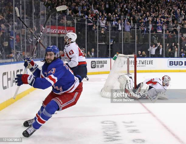 Mika Zibanejad of the New York Rangers scores his fifth goal of the game in overtime to defeat Ilya Samsonov and the Washington Capitals 5-4 at...