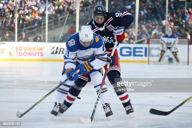 Mika Zibanejad of the New York Rangers skates against Evan Rodrigues the Buffalo Sabres during the 2018 Bridgestone NHL Winter Classic at Citi Field...