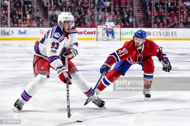Mika Zibanejad of the New York Rangers skates the puck against Paul Byron of the Montreal Canadiens in Game Five of the Eastern Conference First...