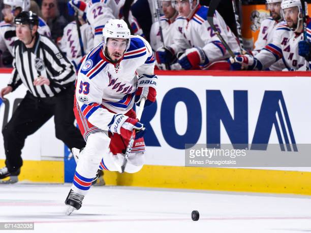 Mika Zibanejad of the New York Rangers skates the puck against the Montreal Canadiens in Game Five of the Eastern Conference First Round during the...