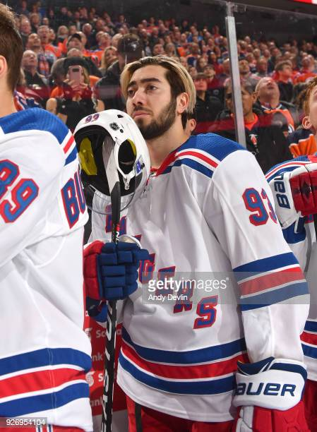 Mika Zibanejad of the New York Rangers stands for the singing of the national anthem prior to the game against the Edmonton Oilers on March 3 2018 at...
