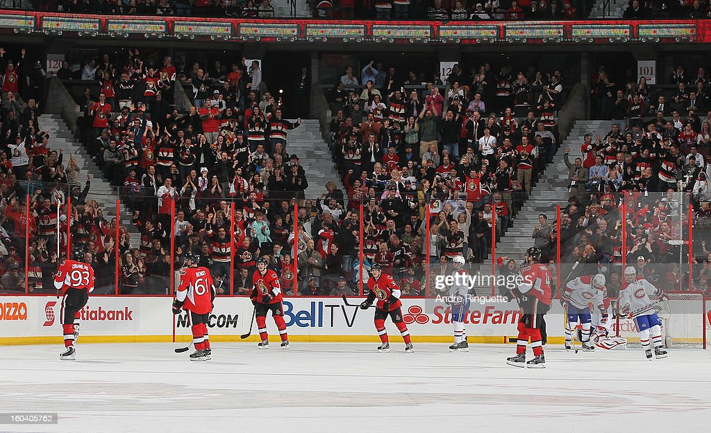 Mika Zibanejad #93 of the Ottawa Senators celebrates his first career NHL goal with teammates Andre Benoit #61, Colin Greening #14, Jakob Silfverberg #33 and Chris Phillips #4 in the second period of a game against the Montreal Canadiens on January 30, 2013 at Scotiabank Place in Ottawa, Ontario, Canada.