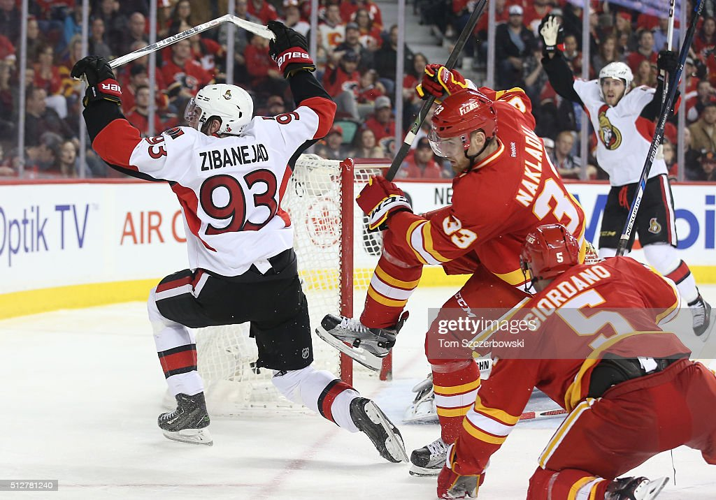 Mika Zibanejad #65 of the Ottawa Senators celebrates his hat trick goal in the third period with Mike Hoffman #68 during their NHL game against the Calgary Flames at the Scotiabank Saddledome on February 27, 2016 in Calgary, Alberta, Canada.
