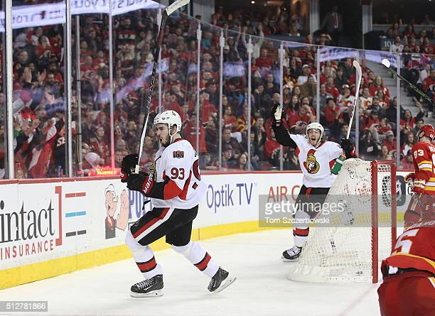 Mika Zibanejad of the Ottawa Senators celebrates his hat trick goal in the third period with Mike Hoffman during their NHL game against the Calgary...