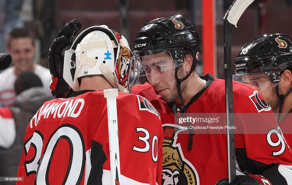 Mika Zibanejad #93 of the Ottawa Senators congratulates teammate Andrew Hammond #30 after their win against the Montreal Canadiens during an NHL pre-season game at Canadian Tire Centre on September 25, 2013 in Ottawa, Ontario, Canada.