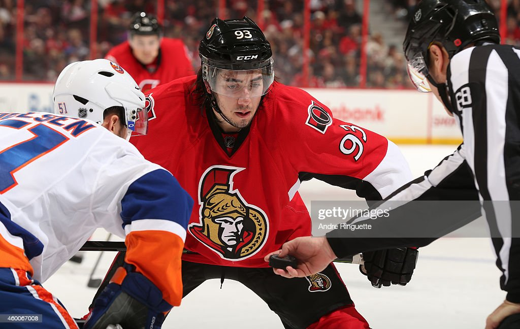 Mika Zibanejad #93 of the Ottawa Senators faces off against the New York Islanders at Canadian Tire Centre on December 4, 2014 in Ottawa, Ontario, Canada.