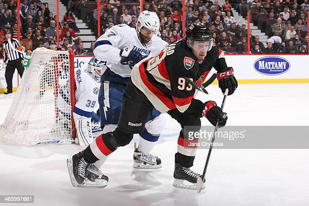 Mika Zibanejad of the Ottawa Senators gets hooked by Radko Gudas of the Tampa Bay Lightning during an NHL game at Canadian Tire Centre on January 30...