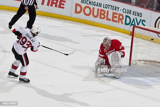 Mika Zibanejad of the Ottawa Senators scores a shootout goal on Petr Mrazek of the Detroit Red Wings during a NHL game on March 31 2015 at Joe Louis...