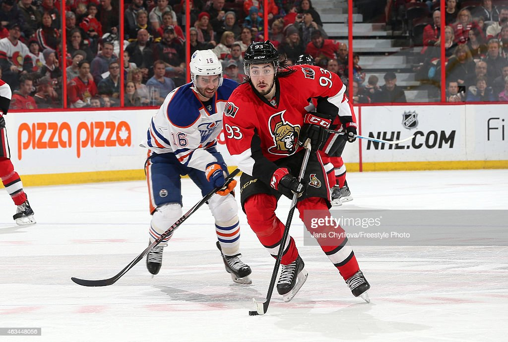 Mika Zibanejad #93 of the Ottawa Senators skates with the puck against Teddy Purcell #16 of the Edmonton Oilers in the second period at Canadian Tire Centre on February 14, 2015 in Ottawa, Ontario, Canada.