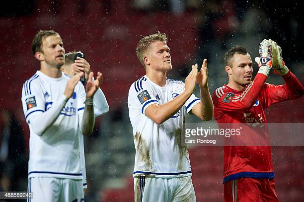 Mikael Antonsson Andreas Cornelius and Goalkeeper Stephan Andersen of FC Copenhagen celebrate their victory after the Danish Alka Superliga match...