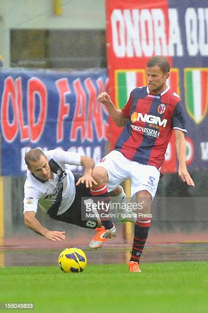 Mikael Antonsson of Bologna FC competes the ball with Rodrigo Palacio of FC Internazionale during the Serie A match between Bologna FC and FC...