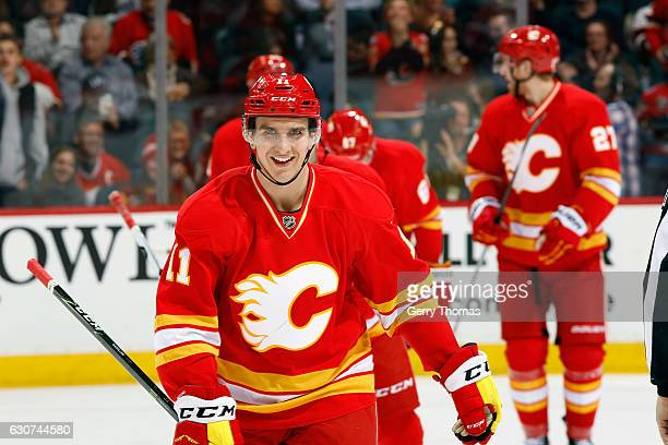 Mikael Backlund and teammates of the Calgary Flames celebrate a goal against the Arizona Coyotes during an NHL game on December 31 2016 at the...