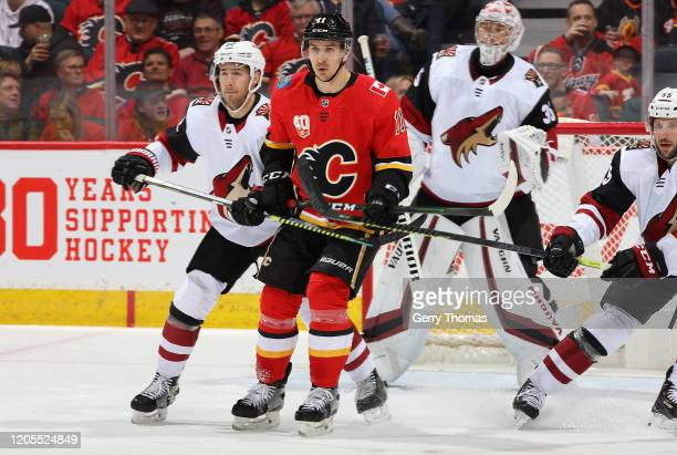 Mikael Backlund of the Calgary Flames battles against the Arizona Coyotes at Scotiabank Saddledome on March 6 2020 in Calgary Alberta Canada