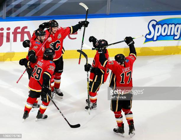 Mikael Backlund of the Calgary Flames celebrates his goal with teammates against the Winnipeg Jets in Game One of the Western Conference...