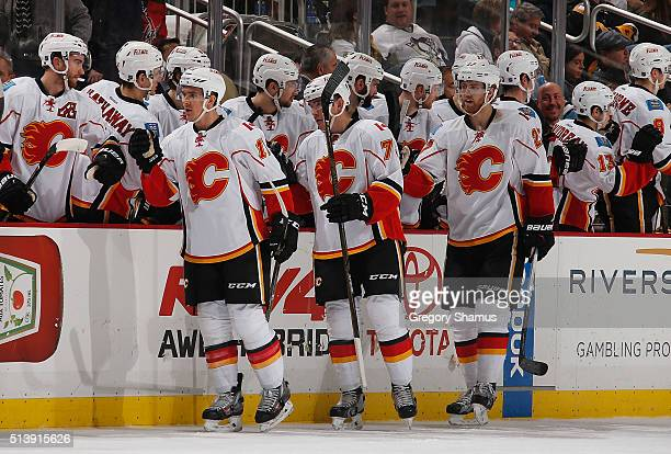 Mikael Backlund of the Calgary Flames celebrates his goal with the bench during the second period against the Pittsburgh Penguins at Consol Energy...