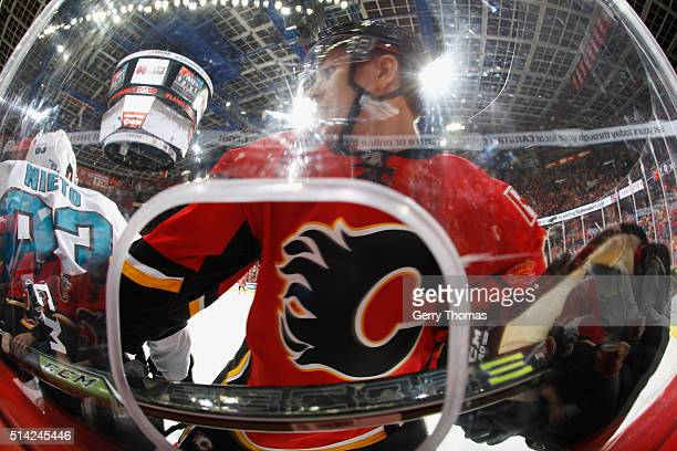 Mikael Backlund of the Calgary Flames gets up close and personal against the San Jose Sharks at Scotiabank Saddledome on March 7 2016 in Calgary...