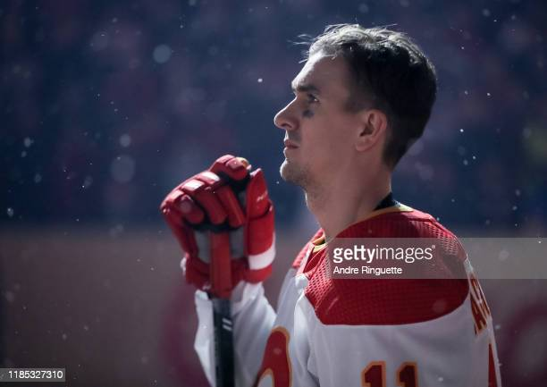 Mikael Backlund of the Calgary Flames listens to the Canadian national anthem before taking on the Winnipeg Jets during the 2019 Tim Hortons NHL...