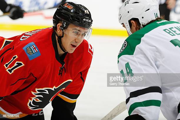 Mikael Backlund of the Calgary Flames prepares to face off against Jamie Benn of the Dallas Stars at Scotiabank Saddledome on March 25 2015 in...