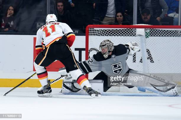 Mikael Backlund of the Calgary Flames scores a penalty shot goal on goaltender Jonathan Quick of the Los Angeles Kings during the third period of the...