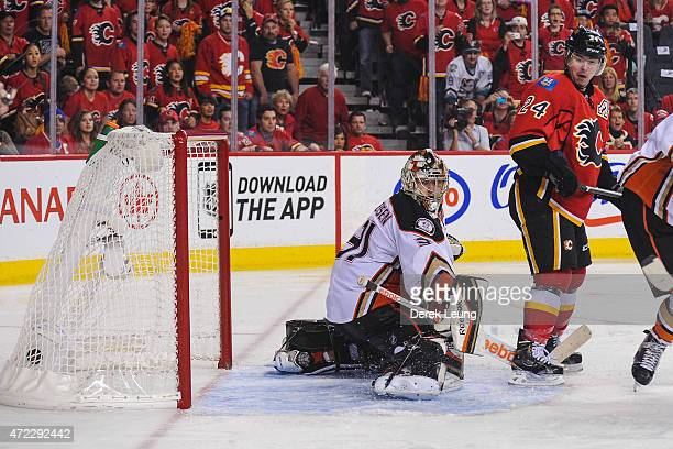 Mikael Backlund of the Calgary Flames scores the game winning goal in overtime against Frederik Andersen of the Anaheim Ducks in Game Three of the...