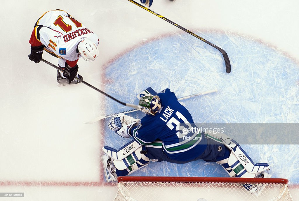 Mikael Backlund #11 of the Calgary Flames shoots the puck as goalie Eddie Lack #31 of the Vancouver Canucks for what proved to be the game winning goal the first period in NHL action on January 10, 2015 at Rogers Arena in Vancouver, British Columbia, Canada. The Flames defeated the Canucks 1-0.
