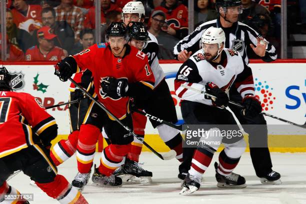Mikael Backlund of the Calgary Flames skates against Brad Richardson of the Arizona Coyotes during an NHL game on November 30 2017 at the Scotiabank...
