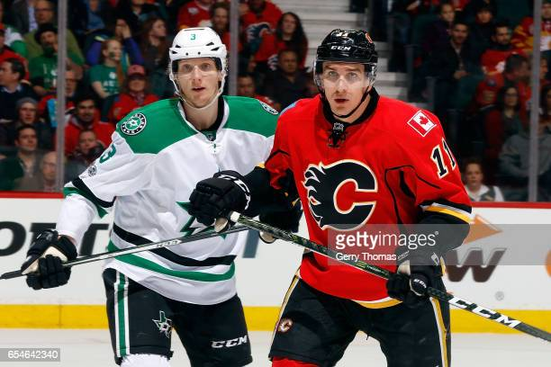 Mikael Backlund of the Calgary Flames skates against John Klingberg of the Dallas Stars during an NHL game on March 17 2017 at the Scotiabank...