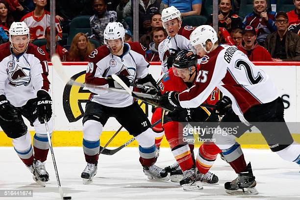 Mikael Backlund of the Calgary Flames skates against Mikhail Grigorenko of the Colorado Avalanche during an NHL game at Scotiabank Saddledome on...