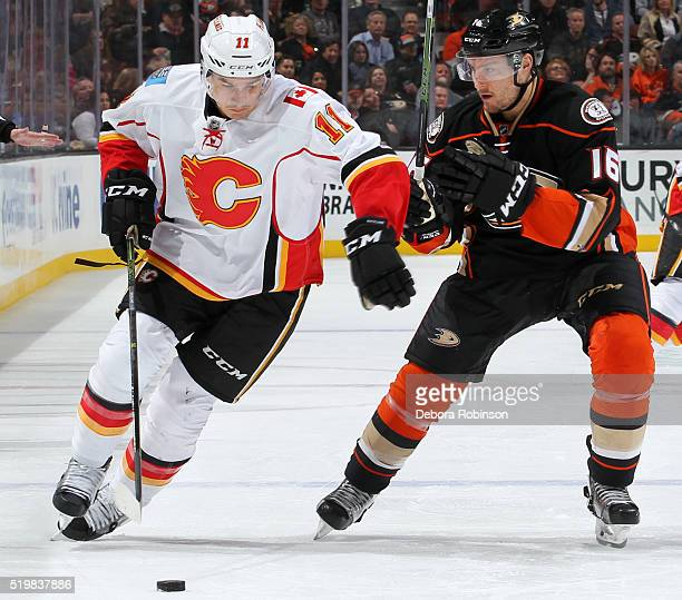 Mikael Backlund of the Calgary Flames skates with the puck against Ryan Garbutt of the Anaheim Ducks on March 30 2016 at Honda Center in Anaheim...
