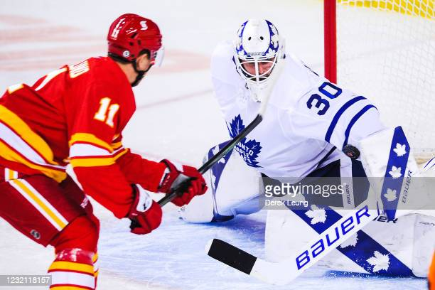 Mikael Backlund of the Calgary Flames takes a shot on the net of Michael Hutchinson of the Toronto Maple Leafs during the first period of an NHL game...