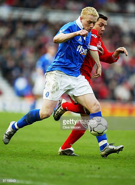 Mikael Forssell of Birmingham City is tackled by Doriva of Middlesbrough during the FA Barclaycard Premiership match between Middlesbrough and...