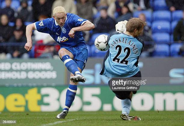 Mikael Forssell of Birmingham City sees his shot blocked by Jussi Jaaskelainen of Bolton during the FA Barclaycard Premiership game between Bolton...