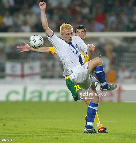 Mikael Forssell of Chelsea and Dusan Shinsky of Zilina during the Champion's League qualifying match between MSK Zilina and Chelsea at the Mestsky...