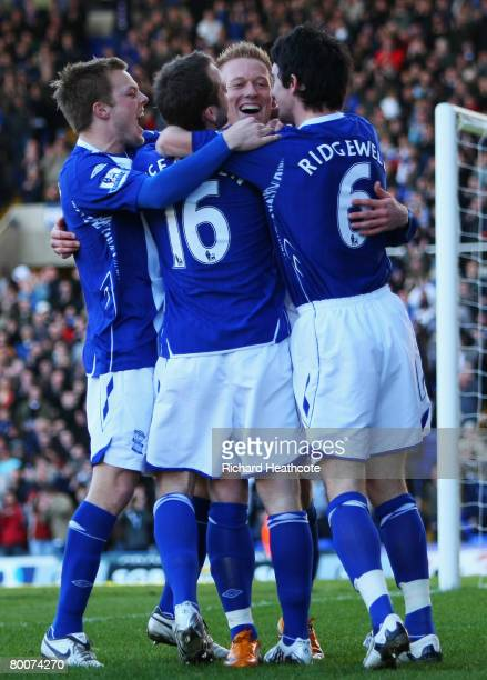 Mikael Forssell of City celebrates his teams opening goal with team mates during the Barclays Premier League match between Birmingham City and...