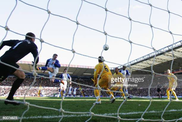Mikael Forssell of City scores his teams opening goal past Paul Robinson of Spurs during the Barclays Premier League match between Birmingham City...