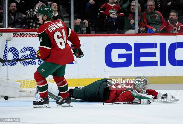 Mikael Granlund and Devan Dubnyk of the Minnesota Wild react after a goal by Vladimir Tarasenko of the St Louis Blues during the third period of the...
