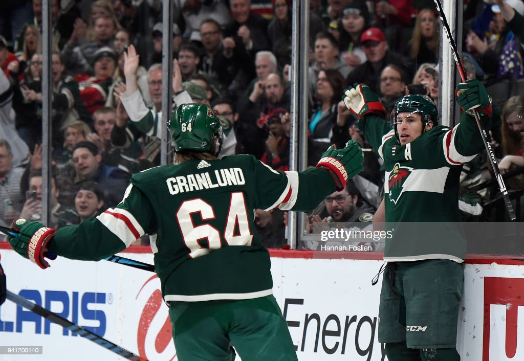 Mikael Granlund #64 and Zach Parise #11 of the Minnesota Wild celebrate a goal against the Edmonton Oilers by Parise during the second period of the game on April 2, 2018 at Xcel Energy Center in St Paul, Minnesota. The Wild defeated the Oilers 3-0.