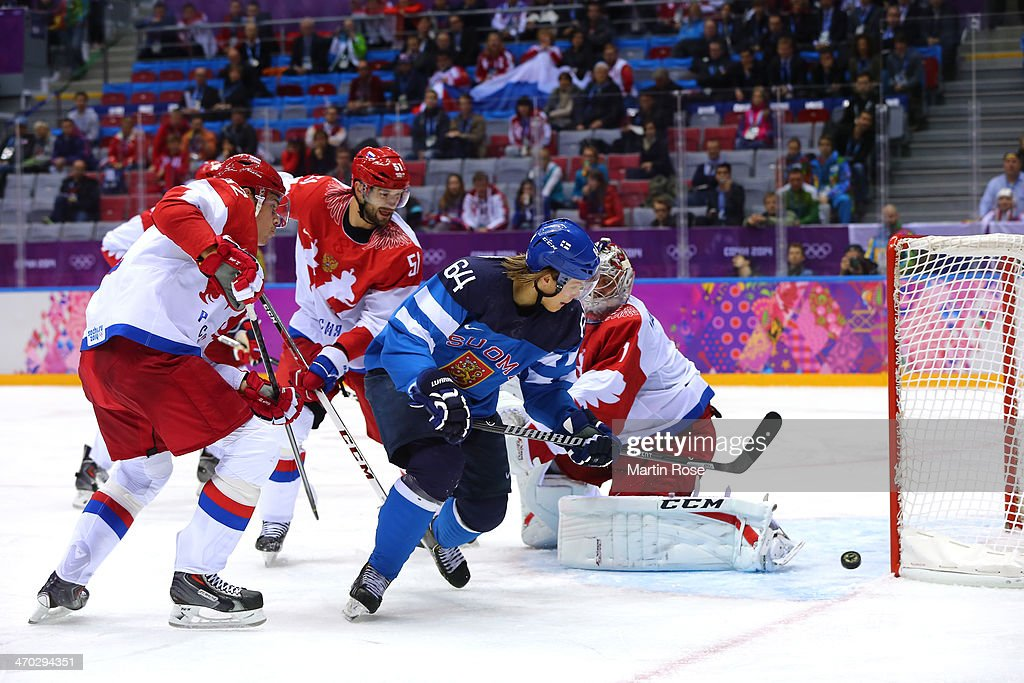 Mikael Granlund #64 of Finland scores a second-period goal against Semyon Varlamov #1 of Russia during the Men's Ice Hockey Quarterfinal Playoff on Day 12 of the 2014 Sochi Winter Olympics at Bolshoy Ice Dome on February 19, 2014 in Sochi, Russia.